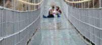 پل شیشه ای قهرمان در چین با ارتفاع ۱۸۰ متر