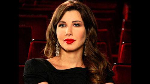 دانلود آهنگ Fi Hagat از Nancy Ajram نانسی عجرم